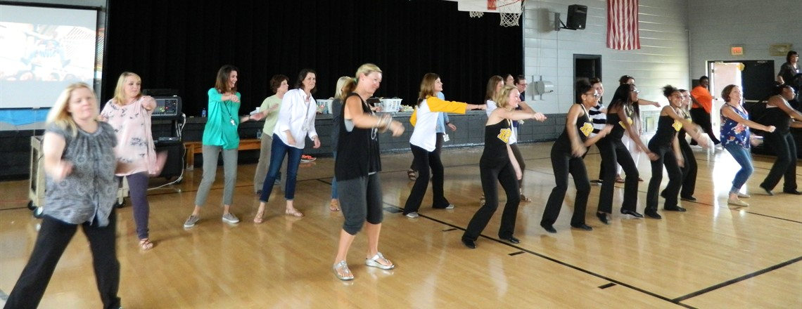 Teachers dance with the Pom Squad at the Pep Rally!