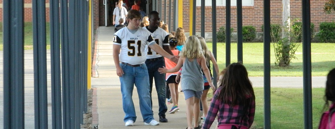 High School Football Players visit RES and high five students on their way to class! Good luck tonight Tigers!