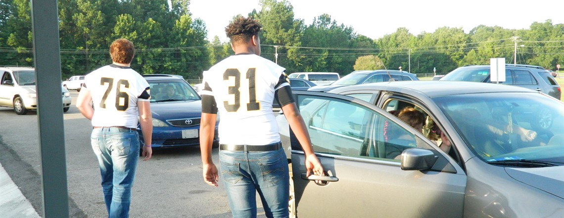 High School Football Players visit RES this morning to open car doors!