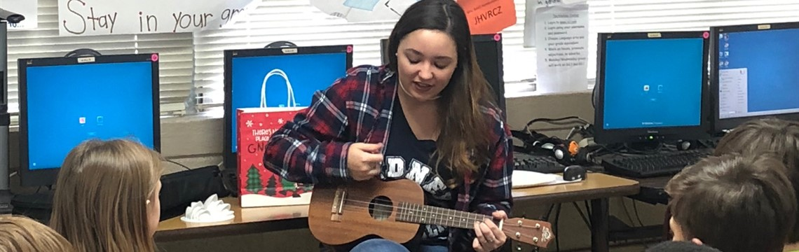 Visitor Caitlyn Jackson plays the ukulele for third grade classes!