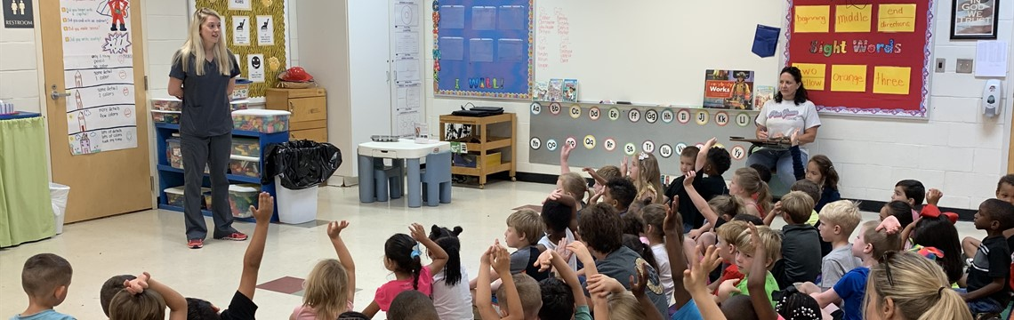 Mrs. Stanford, an optometrist, speaks to the kindergarten students!